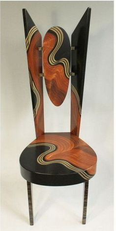 """Daniel Grant and Ingela Noren creates artistic, Burl Swing Wing Chair. Back piece is adjustable for lumbar support. Hand painted and lacquered faux finish chairs. * Size: 20"""" L. x 18""""W. x 51""""H. Shippi"""