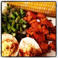 Dinner.  Sweet potatoes, asparagus, corn and deviled eggs.