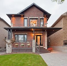 Red brick house, dark trim