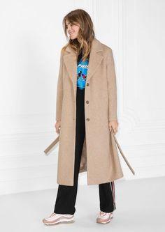 A woman in a camel coat