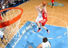 Goran Dragic floats into the lane for two