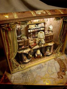 Interior built inside of a book! By Maritza Miniatures