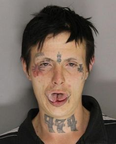 Freak with \'Satan\' tatoo gets life sentence for murder