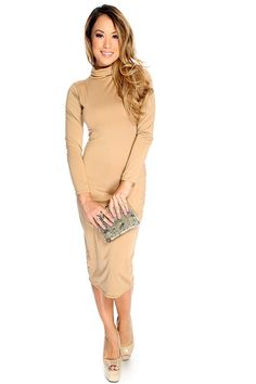 The perfect dress for any occasion! This dress features turtle neck style, long sleeves, knee length followed by a body con fitted wear. Wear this dress with any single soles of your choice for the perfect look. 100% Polyester