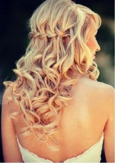 Turn your look up a notch by incorporating a waterfall braid into your curly locks!