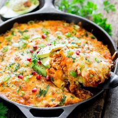 Chicken Tamale Casserole in a Skillet made from scratch! Delicious cornbread crust topped with shredded chicken, enchilada sauce and loads of cheese, yet only 312 calories per serving!
