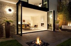 I love how the room opens wide to the outdoors, and I love the beautiful, rocky fire pit.