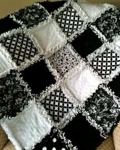 "Black and white quilt! Use fabric that will fray (i.e. double flannel),  after all pieces are sewn together, the raw seams must each be clipped about every 1/2"" and then the blanket washed/rinsed and dried in dryer to produce the most 'fuzzy' seams."