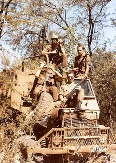 Military personnel of the defence forces of South Africa pose in Buffel armoured personnel carrier.