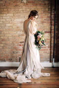 We can't get enough of this dress: http://www.stylemepretty.com/2015/05/04/part-ii-organic-minimal-wedding-inspiration/ | Photography: Megan Robinson - http://www.meganrobinsonblog.com/