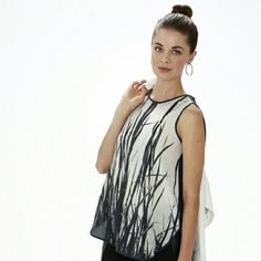 NWT*Leaves of grass* by Randall McRobetets This stunning piece of art is feuturing a flattering A-line a rounded asymmetrical hem, and a design inspired by the beauty in the simple unadorned sides we don't notice unless we are looking! This top will make you look and feel effortlessly beautiful day or night! Material content 100% Silk!!! Solid black back with a zipper closure ,sleeveless.( coming up soon) please do not purchase this listing send me a message with your desired size and I will…