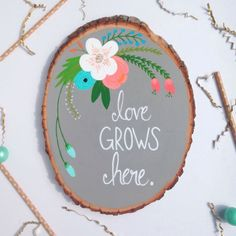 Love Grows Here // Wood Slice Art // Nursery Decor // Home Decor // Wall Decor // Hand Painted // Unique Gift // Hand Lettered by AmandaJohnsonDesigns on Etsy https://www.etsy.com/listing/247419305/love-grows-here-wood-slice-art-nursery