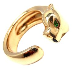 CARTIER PANTHÈRE Yellow Gold Onyx Tsavorite Garnet Ring | From a unique collection of vintage band rings at http://www.1stdibs.com/jewelry/rings/band-rings/