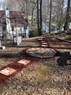 Spring 2014 - Red mulch added a touch of pizazz to the mosaic patio and path I created from  recycled red edging stones found on Craig's List.  Pea pebbles were added to the inside of the square stepping stones.