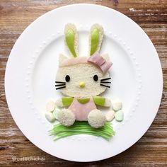 Hello Easter Kitty! She is made with white bread, honey ham, green apple, black licorice for the eyes and whiskers, Nerds candy for her nose, marshmallows for the eggs, and edible grass.