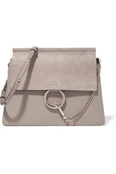 Chloé's gray shoulder bag is part of its coveted 'Faye' collection. Expertly made from a tactile mix of suede and leather, this slim design opens to an accordion-style interior with roomy compartments and a secure zipped pocket. We especially like the house's polished gold equestrian-inspired hardware.