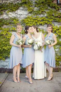 Bridesmaids in lavender. Photography by weddingsbytwo.com