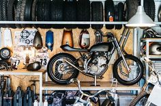 Garage scenes by @thomaswalk the carby fed 2014 350sxf powered, 2008 250excf chassis, BMW frontend, TS125 tank, custom KTM, yea I know I'm confusing  #engineeredtoslide
