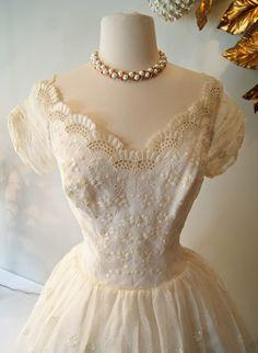 Bodice of 50's eyelet wedding dress, available at Xtabay Vintage Bridal Salon.