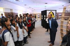 Navi Radjou and the children of Teach for India and Aseema school visiting the Wave exhibition, before attending to Meena Naik's Puppet workshop