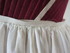Petticoat: cord-gathered, and then whip stitched to twill tape band.