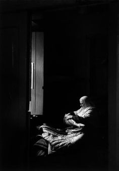 USSR. Russia. Zagorsk. 1958. A Russian Orthodox nun sewing in a convent. | Cornell Capa