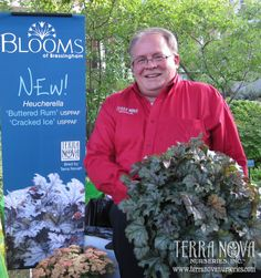 Terra Nova Nurseries' Co-Owner and General Manager Ken Brown showcases Heucherella 'Cracked Ice' at the Blooms of Bressingham Reception during OFA.