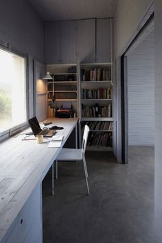 Great idea to divide off a bedroom to create a workspace which can be open or closed, great for hiding mess!