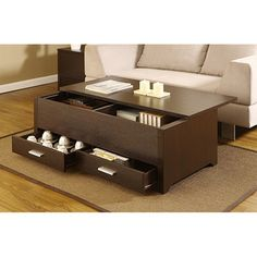 @Overstock - Materials: Wood, veneer, MDF  Finish: Dark espresso  Two (2) deep drawers and a sliding table top panel provide plenty of storage space  http://www.overstock.com/Home-Garden/Knox-Dark-Espresso-Storage-Box-Coffee-Table/6237346/product.html?CID=214117 $169.19