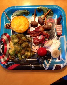Clockwise- Iron Man's Arc Reactor Eggs, Thor's Lightning Bolt Bacon and Sausage Hammers, Captain America's Fruit Shield, Incredible Hulk's SMASHbrown Casserole