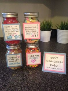 "Gummy fish, gummy worms, gummy bears, and Reese's pieces! Cute little addition to the hubby's anniversary gift! Cheap, simple, and creative! He loved it! He then followed to empty one of the jars, add sour keys, and write a cute note that ended with ""you hold the key to my heart"". Clever. Another jar you could add…"