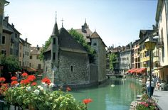 Famous prison surrounded by beautiful old buildings of shops, cafes and apartments- Annecy, France