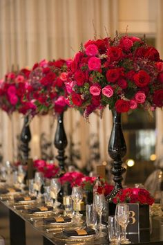 Red and gold themed wedding. Tall centerpieces with roses make for elegant and upscale wedding table decor. | Photo: Blumenthal Photography, Australia