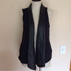 Nordstrom Black/ Leather Sleeveless Cardigan Nordstrom black faux leather sleeveless cardigan best for sizes small to medium this also has pockets on each side Nordstrom Sweaters Cardigans