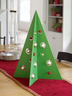 Here's a truly evergreen centerpiece: This modern take on a festive fir won't wilt, doesn't need watering, and can be stored flat, then hauled out season after season. For this 24-inch-high tree, we cut two sheets of lauan into full-size triangles. See how!