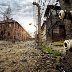 --- Photo by @juanjo_ --- Auschwitz I. Between the fences. Block 22 on the left was part of the prisoners' compound. The building on the right was already a part of SS administration and it housed the infirmary for the guards.