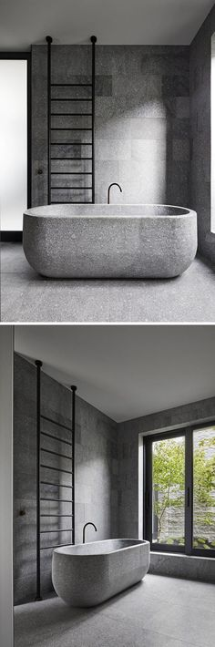 In this modern bathroom, a freestanding bathtub has been carved from a single granite block. Black accents like the faucet and towel ladder tie in with the window frames and create a contrast to the grey granite stone. New Modern House, Modern Room, Modern Bathroom Design, Bathroom Interior, Stone Tub, Granite Bathroom, Modern Windows, Grey Bathrooms, Bathroom Black