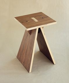 """The simplified version of a stool """"Tower"""". The design was reconsidered and made fully collapsible for flat packing for easier transportation. The stool easily gathers in a minute. The Tower II stool made of high-quality birch plywood coated with walnut ve…"""