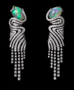 Cartier: African Influences – High Jewelry Earrings Platinum, two cabochon-cut opals, brilliants