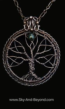"Rowan ""Delight Of The Eyes"" This oxidized copper wire wrapped Tree of Life is enclosed within the eternal circle of life. Branches that form the blossoming fruits, point to the Green Tourmaline ""The soul"". Suspended from a large link decorative copper chain, this pendant brings the wearer into ""The Delight Of The Eyes"" of all. www.sky-and-beyond.com"