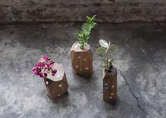 Polka dot faceted vases by Stampel - via the Design Files blog
