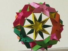 Starball - Another ball with stars; only 12 this time... I used paper that meisures 15 x 15 cemtimeters... Blog where I found the starball: http://yamaorigami.blogspot....