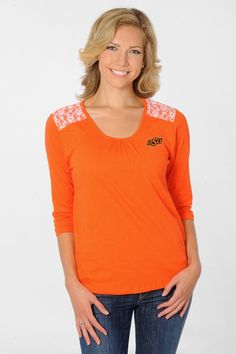 Combine your spirit with your great style in this Oklahoma State Cowboys Women's Lace Shoulder Top from University Girls Apparel!