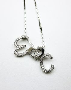 Custom Diamond Initial Pendant perfect for Mother's Day!
