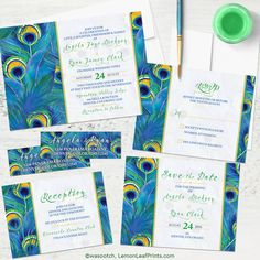 Watercolor painted peacock feather wedding invitation set. A great choice for a spring or summer peacock wedding or a peacock wedding in a hot and sunny spot.