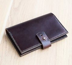 The Wanderer travel wallet in dark brown Horween Chromexcel leather with pine green stitching.  Up for grabs here: http://ift.tt/2lcW529  This design features 2 large pockets for 3.5 x 5.5 inches notebooks or passport travel pass & cash 2 card slots & a pen loop that also works as a strap closure  to hold everything in. Choice of 7 stitching colors. . . . . . . #leathergoods #leather #bengjyminu #horween #style #mensstyle #handmade #smallbiz #handstitched #leatherwallet #horweenwallet #edc…
