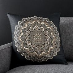 Shop Black Decorative Pillow. A tiny gold earring was the core inspiration for this exuberant pillow designed by Manish and Madhulika Tiberwal.