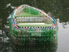 This has got to be one of the coolest things I've ever seen.  A boat made from plastic bottles!  I wonder if I could go tubing with it...xD