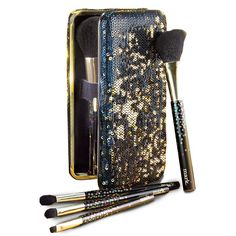 Two critical components of a dazzling night out come together for the ultimate multipurpose present. Powder, blush and three eye shadow brushes included.While supplies last.