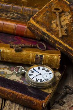 Love Old Books decor. hang watches/old keys on chains in book for a cute look